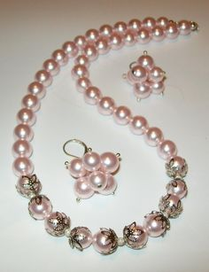 """""""Start with colorful pearls, some bead caps, ball head pins and earring wires. Use the caps near your centre, then place the small crystals between the larger pearls."""""""