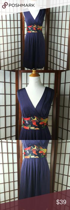 "Sleeveless Pleated Empire Waist Silky Ribbon Dress Pre-owned gently worn  TED BAKER SIZE 1 Sleeveless sleeve style  Empire waist dress style  Multicolor  (purple, black, orange, etc..) Pleated cocktail dress  Wide silky waistband  Side zipper Long wide side ties Lined bust Made of viscose   Measurements approximate  Pit to pit 16"" Shoulder to hem 38"" Waist 27"" Ted Baker Dresses"