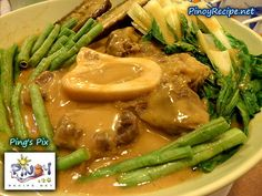 Kare-kare  is made from peanut sauce with a variety of vegetables, stewed oxtail, beef, and occasionally offal or tripe.  Meat variants may include goat meat, chicken or rarely fish. It is often eaten with bagoong (shrimp paste), sometimes spiced with chili, and sprinkled with calamansi juice.    Read more: http://www.pinoyrecipe.net/beef-kare-kare-recipe/