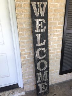 Welcome sign on old fence pickets