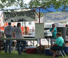 This is Kathy Cornett's photo of the Centralia Young Farmers booth at the Centralia Anchor Fest 2014.