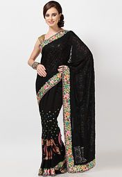 Perfect for all formal and semi-formal occasions, this black saree by Hiba is a must-have in your ethnic closet. While the attractive embroidery work makes this saree visually appealing, the viscose fabric will keep you comfortable all day long.