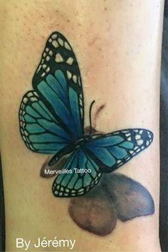 Tatouage papillon bleu réalisé par jérémy