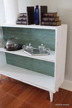Loving the back of the open cabinet shelves on this painted furniture makeover!