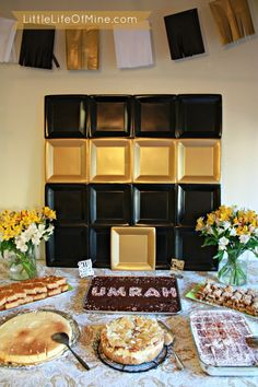 Kaa'ba paper plate display with tissue paper bunting for Umrah/Eid party.