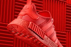 Color Boost NMD Pack Available in three colorways In store Online from September 17 adidas Originals ● S t a y T u n e d ● The pack includes three upcoming adidas NMD colorways as part of their Fall Collection featuring the adidas NMD_XR1 and two NMD_R1 models. Two out of the three pairs come dressed in a Black color scheme, while one of the adidas NMD_R1s comes in Solar Red. adidas adds the new mesh upper constriction to the latest adidas NMD releases, while the NMD_XR1 features a mi....