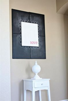 LOVE her black chalk board canvases display- cld change out front canvas for each holiday - modern and classy