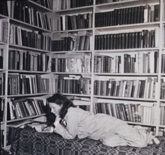 Edna St. Vincent Millay in her library, ca. 1940.