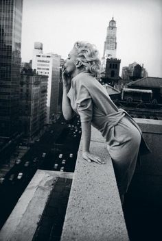 Marilyn Monroe smoking on a rooftop.