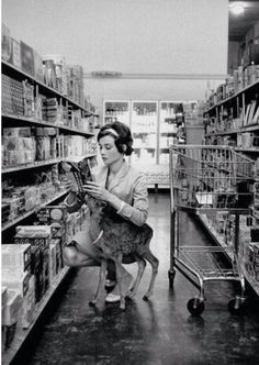 Audrey Hepburn grocery shopping with pet deer (1956)