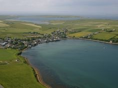 This is the village of Burray looking south towards the island of South Ronaldsay -- http://www.orkney.com/site/assets/files/1616/3ca0ce79-b09f-4883-8523-adf39d09ef34-m.jpg