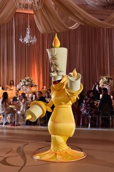 """Lumiere performed """"be our guest"""" to kick off the dinner service at this reception"""