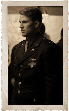 A torn photograph of Steve in his captain's dress uniform. Postedvon tumblr.com by stark-the-mechanic.