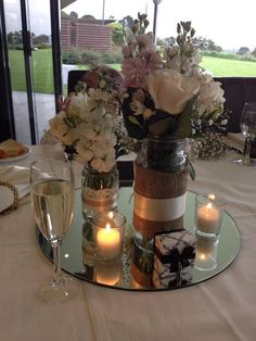 Our wedding table centrepiece - jars were purchased from op shops and I bought the lace, ribbon and hessian from ebay :)