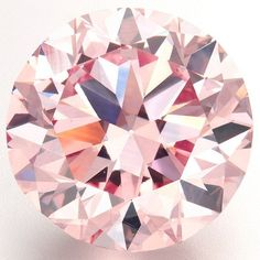 """The """"Martian Pink"""", a 12.04-carat Fancy Intense pink (Type IIa) diamond, is shown during a media preview at Christie's. The """"Martian Pink"""" was named by American jeweller Ronald Winston in 1976."""