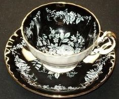 AYNSLEY ENGLAND WHITE ROSE GOLD BLACK FOOTED TEA CUP AND SAUCER by tracie