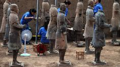 Archaeologists at work at the excavation site inside the No 1 pit of the Museum of Qin Terracotta Warriors and Horses in Xian, China, 09 June