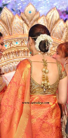 Tamanna's embroided Saree Blouse infact the entire attire is pretty. Don't miss the gajras! :)