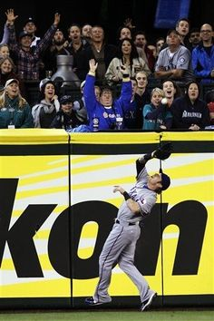 Texas Rangers' Josh Hamilton makes a running catch on a ball hit by Seattle Mariners' Casper Wells with the bases loaded to end the first inning of a baseball game, Tuesday, May 22, 2012, in Seattle. (AP Photo/Ted S. Warren) game 44