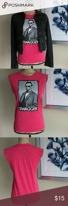 """'SWAGGER' Muscle Tee in Red Size Medium """"It's about the art."""" ODM Awesome Red Muscle Tee. Size Medium. Features 'SWAGGER' below a great Graphic of President Abraham Lincoln wearing shades &a red bow tie. Red sleeveless T-shirt. In great condition! No stains, Rips, tears or holes. Feel free to ask any questions. MAKE ME AN OFFER! FREE GIFT with every purchase! Bundle for further discounts. ODM Tops Muscle Tees"""