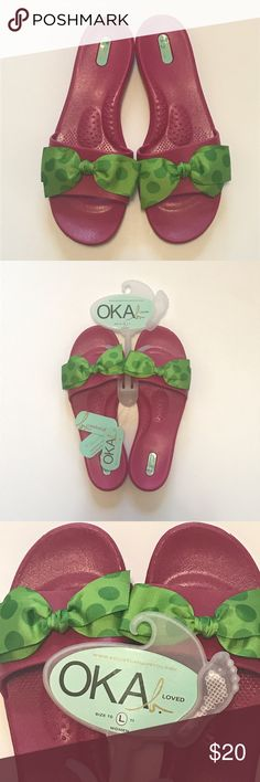 Okabashi Madison Flamingo Pink Flipflops/Sandals This is a really cute & fun pair of Okabashi Madison Flamingo Pink Flipflops/Sandals. They are a bright pink with the cutest green on green polka-dotted ribbon on them. They have a rubber/silicone feel, have message beads & arch support, & are non-slip. Perfect for the beach, pool, or anywhere! Okabashi Shoes Sandals