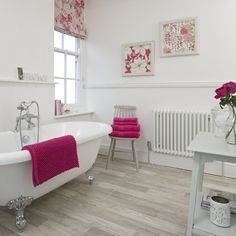 We love this beautiful country home bathroom, traditional in style but with a splash of the modern in the hot pink prints and accessories. It looks clean, bright and just the kind of place we'd love to take a soak in that claw-footed rolltop bath!