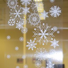 "These fabulous large snowflake border window cling decals are perfect for the sides and bottom of large windows. Each panel is approx. 39"" in length and 12"" wide. Printed in white on clear vinyl cling"