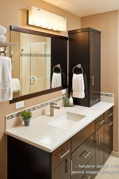 Modern 3/4 Bathroom with Quartz counters, frameless showerdoor, Crystal White Quartz, George Kovacs 6 Light Wall Sconce