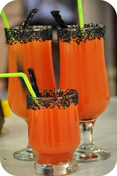 I always have a fun drink for the kids and this year it was an orange juice spritzer with a touch of grenadine to give it a nice red color and then added a couple extra touches with the black sanding sugar and black twizzler garnishes.