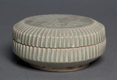 Covered Box with Carved Floral Design: Yaozhou Ware, 1100s China, Shanxi province, Northern Song dynasty (960-1127) glazed stoneware, Diameter: w. 10.70 cm (4 3/16 inches)