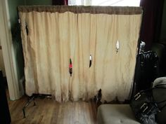 """Creepy room divider - This is a nice stand alone idea for a haunt.  This person planned to use lighting to set up a """"shadow"""" skit of a doctor disemboweling a victim.  From Halloween Forum"""