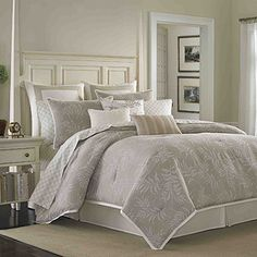 Serene and elegant features neutral tones and textures. The jacquard comforter and shams feature textured fern fronds in chalk white on a contrast weave, textured ground in a taupe linen color edged with a crisp white cotton flange adds tailored details