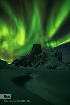 Over the Asgard - Pinned by Mak Khalaf Important: Please click on the photo to view it on black. Staying near the Mt. Asgard on Baffin Island brings unforgettable memories. There is no doubt about it. But being there while northern lights start their dance can only be compared with some sort of a nature made catharsis. When aurora borealis arrives on the sky the whole previously deeply obscure area of Turner Glacier explodes with the green glow. This hostile and frozen terrain for a moment…