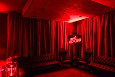 Inside, the venue was lighted in red and featured a neon sign that spelled out the name of the...