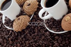 cup of black coffee with cookies. - Detailed shot of a cup of black coffee with cookies.