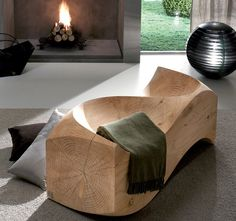 Add that spark of abstract art in your indoor furniture by installing this beautifully sculpted Solid Cedar Loveseat By Jake Phipps.