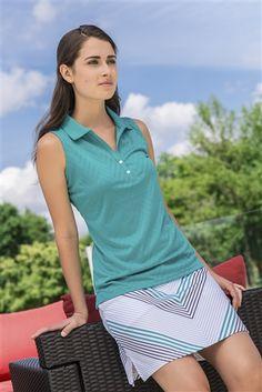 AUR Women's Glennifer Knit Golf Skort, paired with a teal sleeveless shirt. Back welt pocket. Undershorts. Side split hem. Active stretch. White, Nightfall Navy, Malibu Green