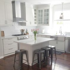 Cottage Farmhouse Features From Light Bright White Ikea Kitchen, subway tile wood floors industrial bar stools White Ikea Kitchen, Rustic Kitchen, New Kitchen, Long Kitchen, Narrow Kitchen, Kitchen Ideas, Kitchen Decor, 1970s Kitchen, Colonial Kitchen
