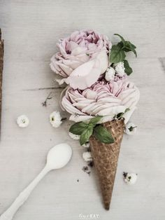 Roses and baby's breath in an ice cream cone. Very pretty!