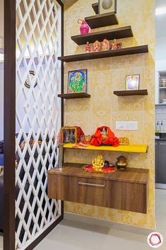 at Mahagun Mywoods gets a splash of colour and functional interiors. Livspace Noida turned this house into a dream home for the homeowners. Indian Home Interior, Indian Home Decor, Temple Design For Home, Modern Small House Design, Pooja Room Door Design, Living Room Orange, Puja Room, Home Design Decor, Room Doors