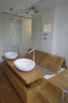 Courtesy of A-OMA | great solution for a small space where the bathroom looks onto/into another area | #smallspace #bathroom