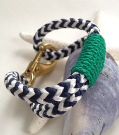 Navy & White Nautical Rope Bracelet with Green Wrap and a Bronze Clasp.
