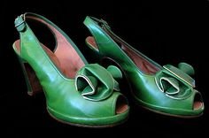 Hey, I found this really awesome Etsy listing at https://www.etsy.com/listing/182330336/chic-1940s-green-leather-peep-toe