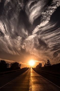 Sunset sky over Highway 30, USA   (by: Jake Olson Studios)
