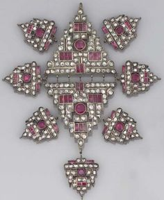 GROUP OF ART DECO DIAMOND AND RUBY NECKLACE PANELS. Comprising a pair of openwork stepped triangular panels set with rose-cut diamonds accented with rubies, and seven smaller panels of similar design, circa 1930.