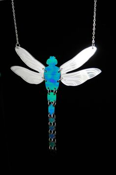 PANIKA holographic dragonfly statement necklace / laser cut perspex necklace by PANIKAUA on Etsy https://www.etsy.com/listing/224194906/panika-holographic-dragonfly-statement