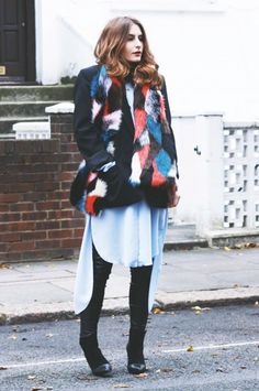Denisia Aghiorghitoaie wearing a multi-coloured fur stole over a black blazer, blue shirt dress and leather jeans.