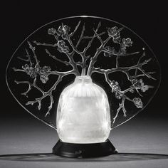 """René Lalique """"BRANCHES DE PRUNUS"""" VEILLEUSE, MARCILHAC NO. 2567 engraved Lalique molded and frosted glass on a wooden base 6 in. (15.3 cm) high. model introduced 1913."""