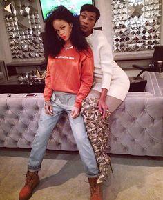 Rihanna wearing Gentlem3ns' Club orange sweatshirt, Topshop Moto bleach dungarees, Timberland boots, Fallon herringbone necklace