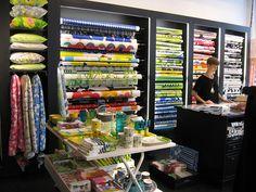 Marimekko Fabric Display, Fabric Storage, Showroom Design, Shop Interior Design, Fabric Houses, Fabric Shop, Textiles, Textile Patterns, Shop Facade